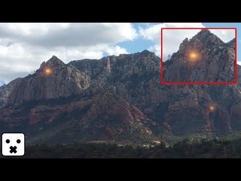 OVNI dorado accediendo a Base secreta en Montaña